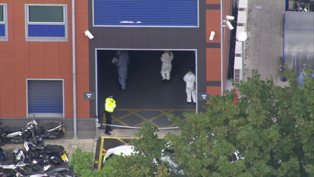 aerial view of forensics officers at a custody centre in croydon where police sergeant matiu ratana was shot dead - boundary stock videos & royalty-free footage