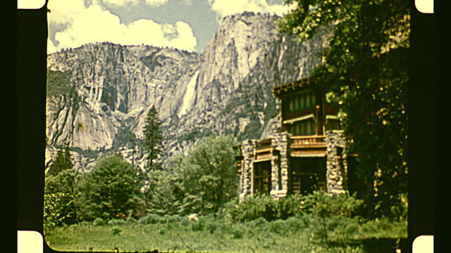 aerial view of forest in yosemite national park and zoom in view on a hotel building in the middle of the forest; various views of the building and... - yosemite national park stock videos & royalty-free footage