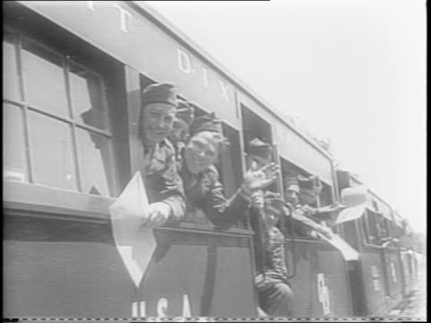 aerial view of fort dix / soldiers fill paperwork / gis receive payment and honorable discharge from army / former soldiers board train and are off /... - former stock videos & royalty-free footage