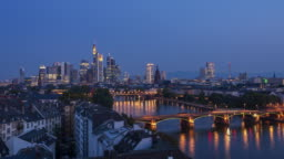 Aerial view of Frankfurt am Main skyline and River Main, night to day 4k time lapse