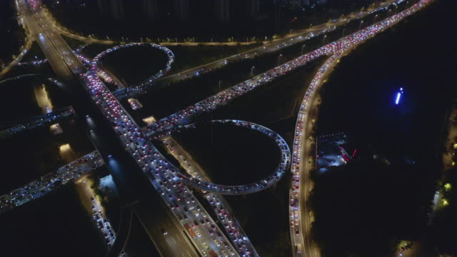 vídeos de stock e filmes b-roll de aerial view of freeway busy city rush hour heavy traffic jam highway - traffic jam