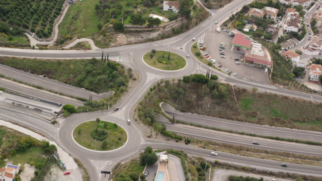 aerial view of freeway entrance with two roundabouts