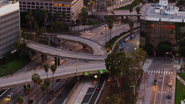 aerial view of freeway exits to downtown la - on the move stock videos & royalty-free footage