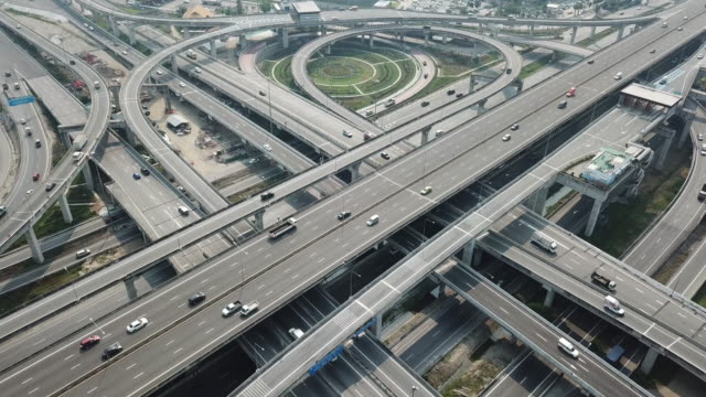 aerial view of freeway intersection road - motorway stock videos & royalty-free footage