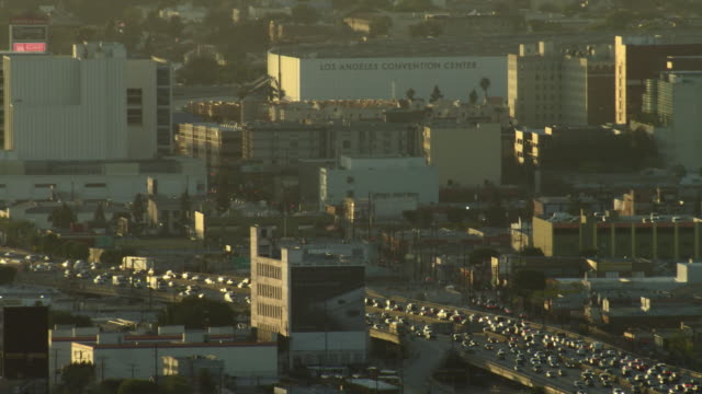 stockvideo's en b-roll-footage met aerial view of freeway near downtown los angeles and the la convention center. - los angeles convention center