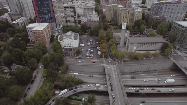 aerial view of freeway passing through city - seattle stock videos & royalty-free footage