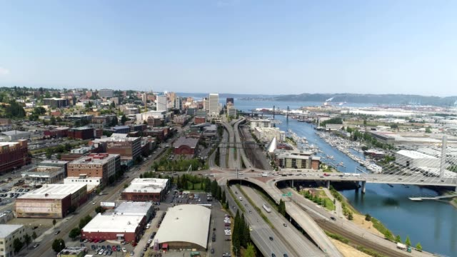 aerial view of freeways and bridges on a sunny day outside downtown tacoma washington - puget sound stock videos & royalty-free footage