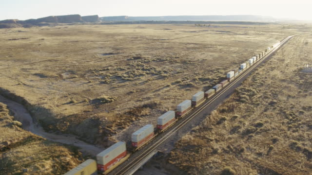 Aerial view of freight train in desert, Gallup, New Mexico, United States