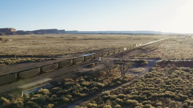 aerial view of freight train in desert, gallup, new mexico, united states - railroad car stock videos & royalty-free footage