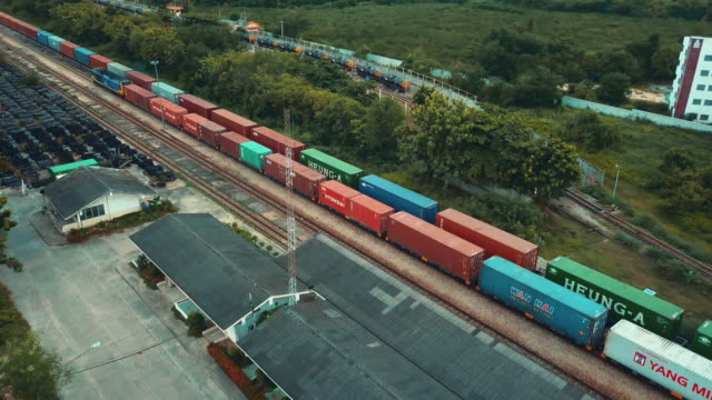 aerial view of freight train with cargo containers - cargo train stock videos & royalty-free footage