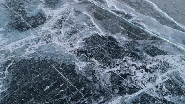 aerial view of frozen baikal lake in winter, russia - eingefroren stock-videos und b-roll-filmmaterial