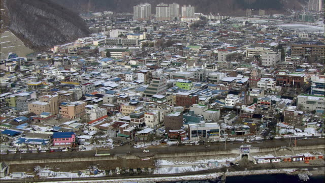Aerial View of frozen river and snow covered Hwacheon city in Korea
