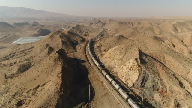 aerial view of fuel tank train in china - power line stock videos and b-roll footage
