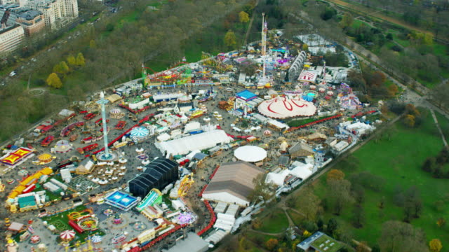aerial view of fun fair in hyde park - the serpentine london stock videos & royalty-free footage