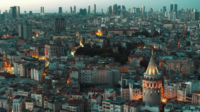 aerial view of galata tower and skyscrapers istanbul at night - 4k drone footage - istanbul stock videos & royalty-free footage