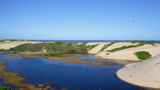 aerial view of genipabu sand dunes, natal, rio grande do norte, brazil - lagoon stock videos & royalty-free footage
