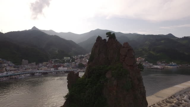 aerial view of geobukbawi rock (geobuk meaning a turtle) and residential village at ulleungdo island - north gyeongsang province stock videos and b-roll footage