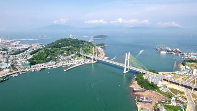 vídeos de stock, filmes e b-roll de aerial view of geobukseondaegyo brige, overhead cable car on the sea and cityscape of yeosu - cable