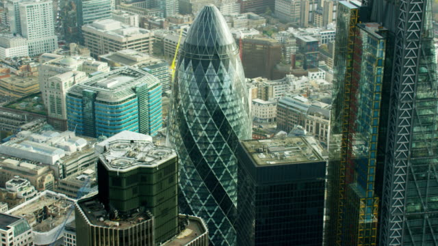 aerial view of gherkin building and skyscrapers london - swiss re stock videos & royalty-free footage