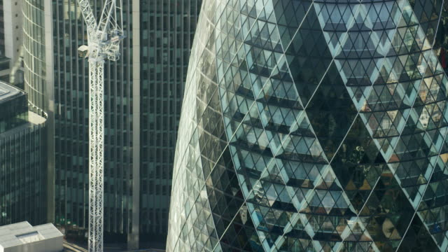 aerial view of gherkin building and skyscrapers london - finance stock videos & royalty-free footage