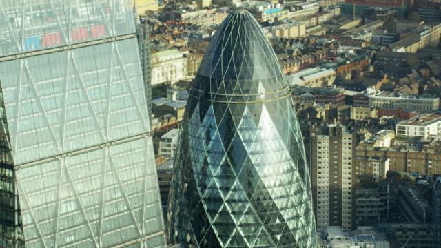 aerial view of gherkin skyscraper building london england - swiss re stock videos & royalty-free footage