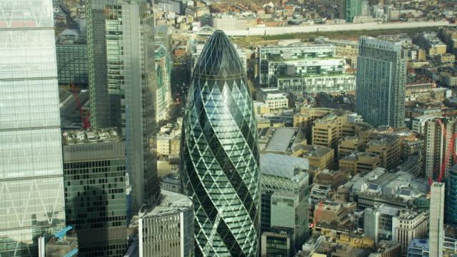 aerial view of gherkin skyscraper london city uk - swiss re stock videos & royalty-free footage