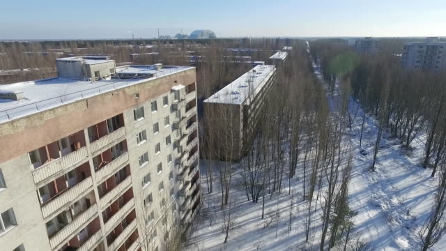 stockvideo's en b-roll-footage met aerial view of ghost town of pripyat which was settled by the chernobyl station workers and evacuated in 1986 after the accident - kernramp van tsjernobyl