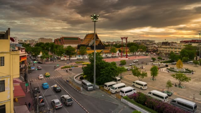 Aerial view of Giant swing and Wat Suthat Temple,Day to night time lapse