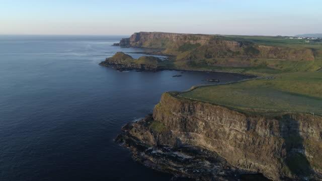 aerial view of giants causeway coastline, antrim ireland - bay of water stock videos & royalty-free footage