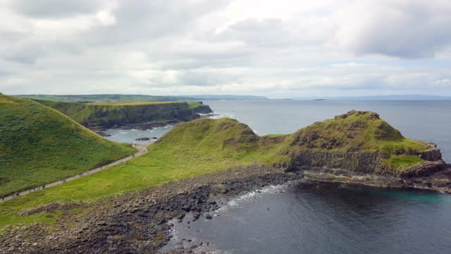 aerial view of giant's causeway with dramatic views along the atlantic coast / northern ireland - basalt stock videos & royalty-free footage