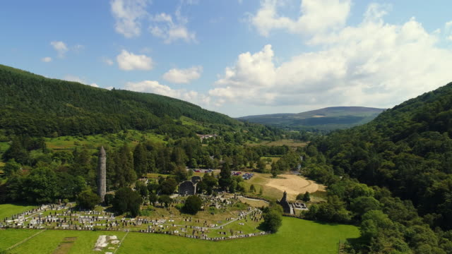 aerial view of glendalough ruins in wicklow ireland - bog stock videos & royalty-free footage