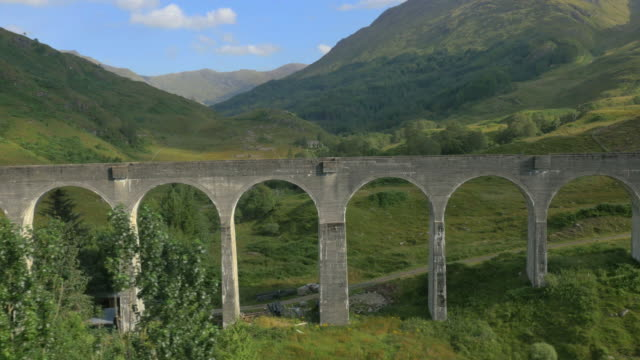 aerial view of glenfinnan railway viaduct scotland uk - steam train stock videos & royalty-free footage