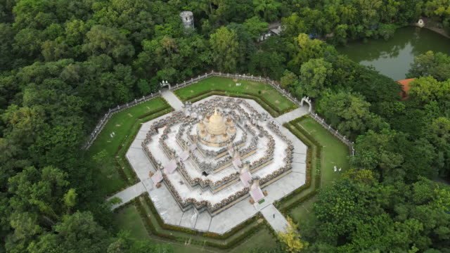"aerial view of golden pagoda ""chedi maha mongkol bua"" in roi-et province, thailand ; zoom out - pagoda stock videos & royalty-free footage"