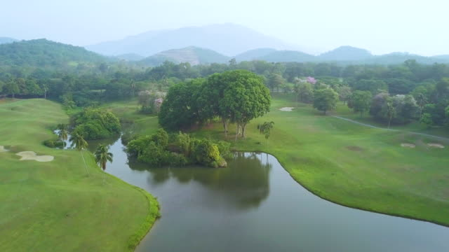 stockvideo's en b-roll-footage met aerial view of golf course - aangelegd