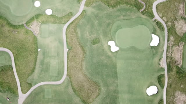 aerial view of golf course - green golf course stock videos & royalty-free footage