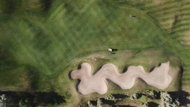aerial view of golfers playing golf - golf course stock videos & royalty-free footage