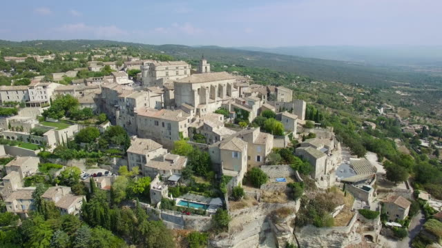aerial view of gordes, labelled most beautiful villages of france - luberon video stock e b–roll
