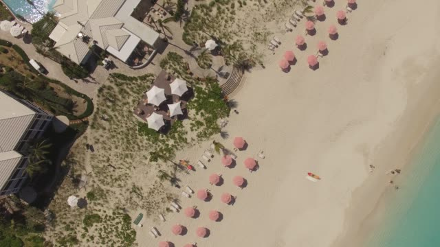 aerial view of grace bay, providenciales, turks and caicos - parasol stock videos & royalty-free footage