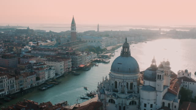 aerial view of grand canal and the basilica of santa maria della salute in venice, italy - wop productions stock-videos und b-roll-filmmaterial
