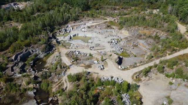 stockvideo's en b-roll-footage met aerial view of granite quarry at sunny summer day - omgeven