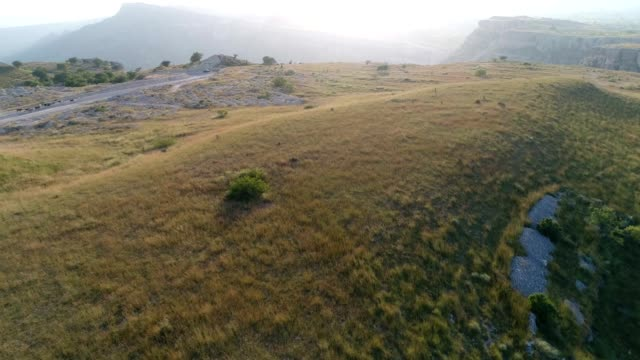 aerial view of grassland in mountains - pakistan video stock e b–roll