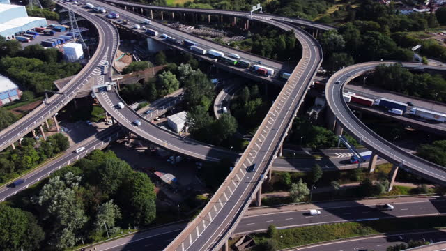 aerial view of gravelly hill interchange (spaghetti junction.) pan r to l, - motorway junction stock videos & royalty-free footage