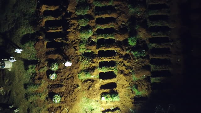 """aerial view of graves being dug in sao paulo for victims of coronavirus - """"bbc news"""" stock videos & royalty-free footage"""
