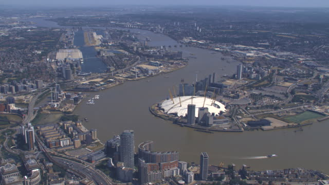 aerial view of greenwich peninsula in london, uk. 4k - building exterior stock videos & royalty-free footage