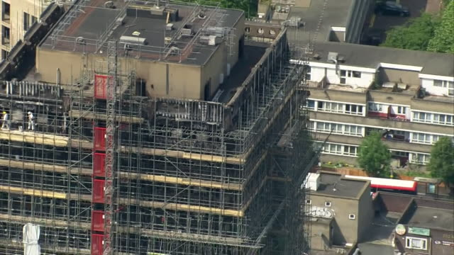 Aerial view of Grenfell Tower with scaffolding and white sheet covering