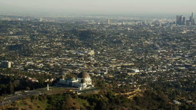 aerial view of griffith park observatory los angeles - observatory stock videos & royalty-free footage