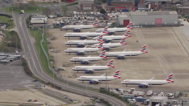 aerial view of grounded british airways planes at an airport during the coronavirus crisis - stationary stock videos & royalty-free footage