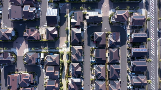aerial view of group of detached houses - inquadratura da un aereo video stock e b–roll