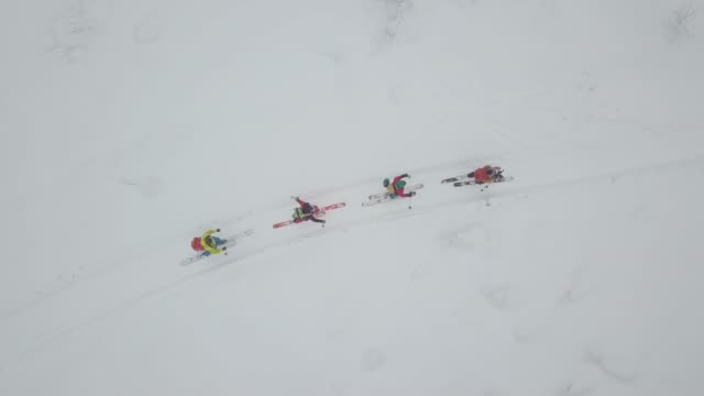 aerial view of group of skiers touring up mountain - four people stock videos & royalty-free footage