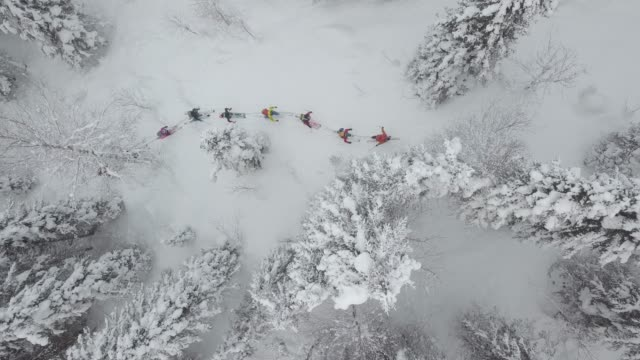 aerial view of group of skiers touring up mountain - 35 39 years stock videos & royalty-free footage